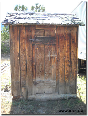 Front view of the 1900's Outhouse