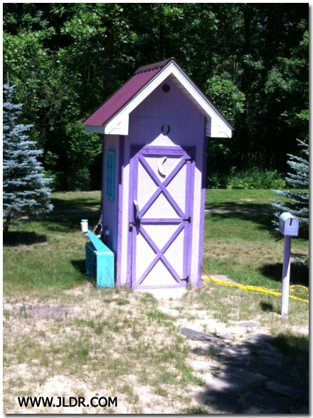 Really Nice Outhouse with a Metal Roof