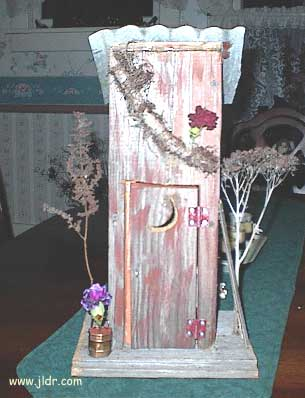 Front view of the birdhouse outhouse