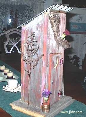 Side view of the birdhouse outhouse