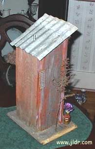 Back view of the birdhouse outhouse