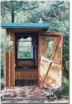 Competed Outhouse with Door Open