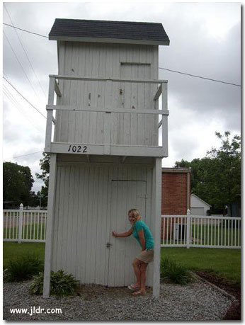 Missy visiting the 2 Story Outhouse