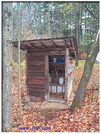 The original Lake George New York Outhouse now serving as a tool shed