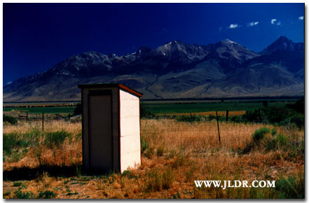 The Old Hatchery Outhouse with the Idaho Mountains in the Background
