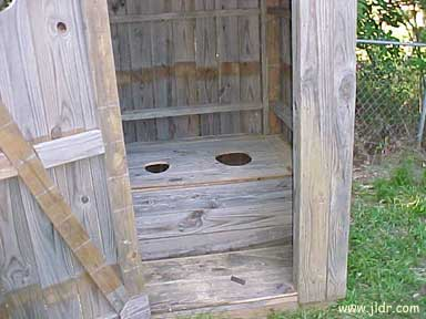 Inside the homemade Outhouse