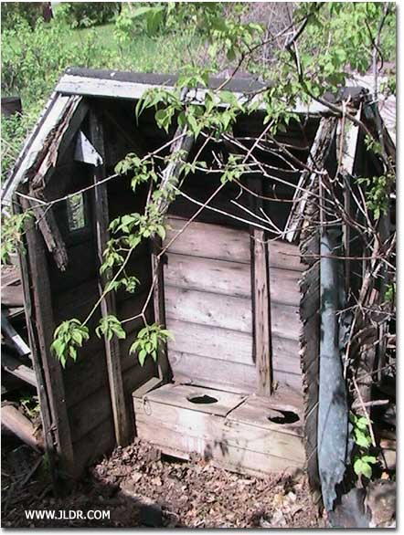 Outhouse before restoration