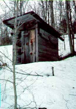Close-up View of the Outhouse