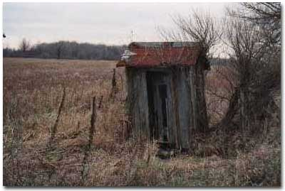 An Outhouse with a Beveled Window