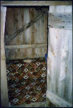 A Carpeted Outhouse