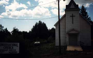 Front View of the Church hiding the Outhouse