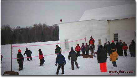 Check out a volleyball game being played on top of a few feet of snow!