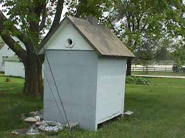 Back View of the Concrete Outhouse Clearly Shows the Concrete