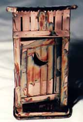 Front View of the Copper Outhouse