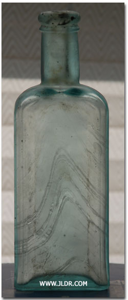 Another view of Hamlin's Wizard Oil bottle