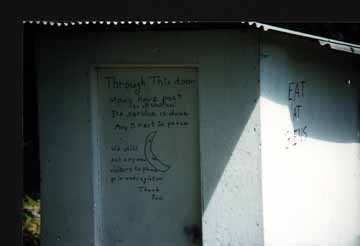 The Writing on the Door of the Outhouse