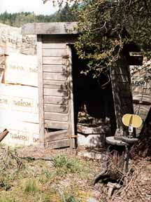 Front entrance showing corner seat in the outhouse