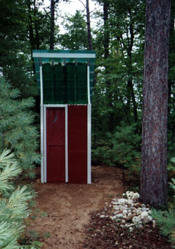 The completed Outhouse with the half moon in the door