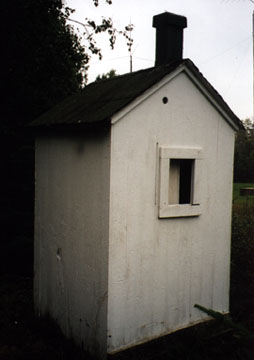 The Back View of the Outhouse