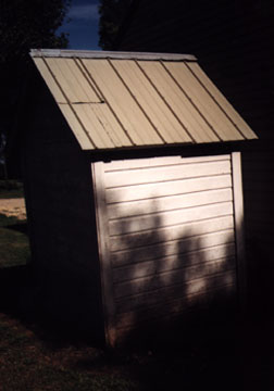 Right side of the Outhouse showing the Tin Roof