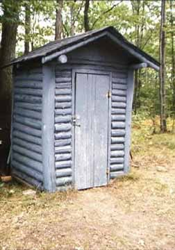 Front View of the Log Outhouse