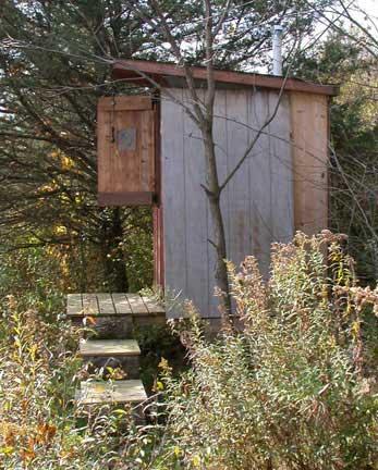 Side View Showing the Finished Outhouse with the Dutch Door Open