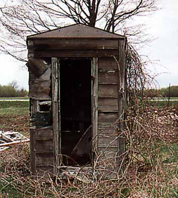 Closeup of Tin-roofed Outhouse