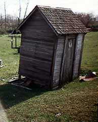 Side View of the Rooster-Doored Outhouse