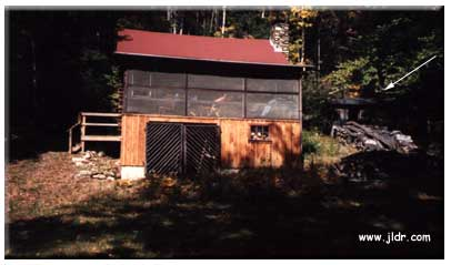 The cabin with the outhouse at the right