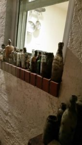 Philadelphia Outhouse dig bottles on the window sill