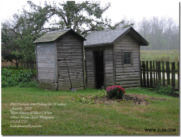 1800's farmhouse outhouse and wood shed