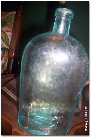 Pounded glass bottle
