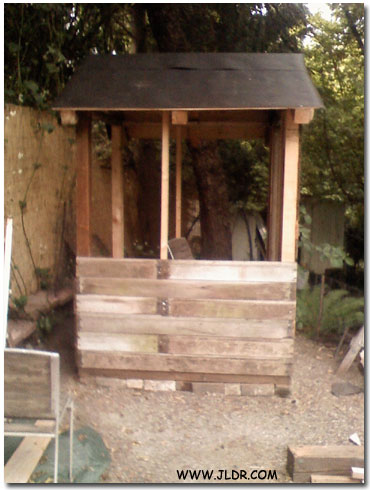 Side view as the Outhouse was being reconstructed