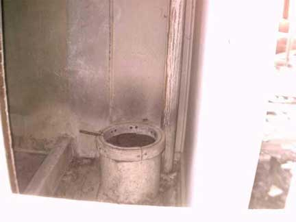 An indoor Outhouse found in a home