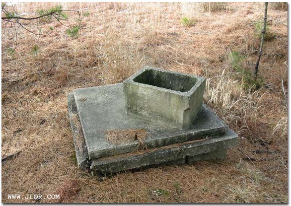 The cement base of a WPA Outhoue built in the mid 1900s